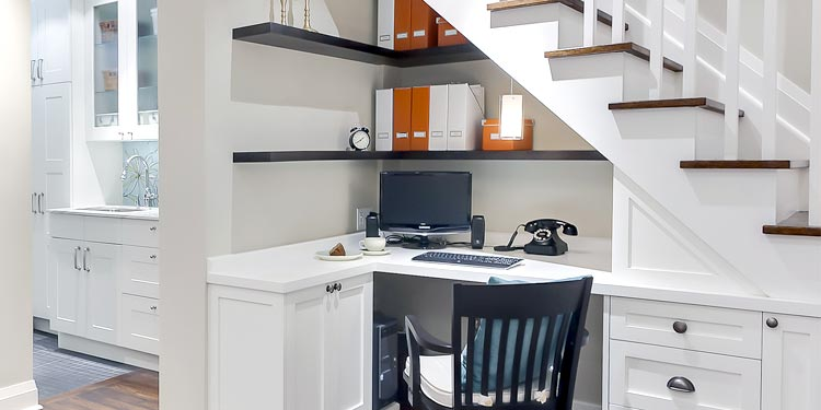 Step up to ways to utilize space under your stairs